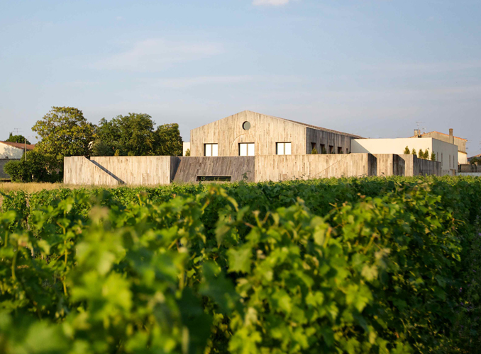 <p>Château Clerc Milon and its vineyard.</p>